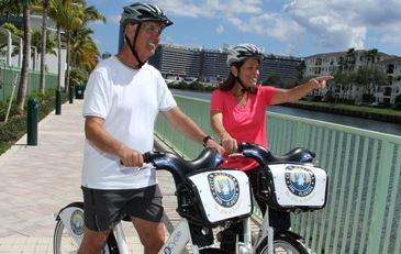 A couple riding Aventura BCycle bikes