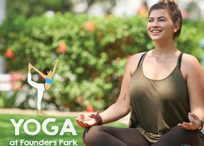 This image contains a girl doing yoga outdoors. This image contains the text Yoga in the Park.